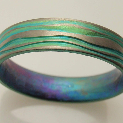 flowy engraved titanium band