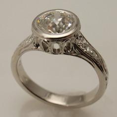 bezel set diamond engagement ring w/ cut through bezel and engraved accents