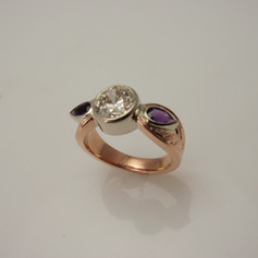 diamond and amethyst rose and white gold three stone ring
