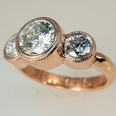 diamodn in rose gold millgrained bezels