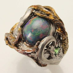 boulder opal in organic titanium