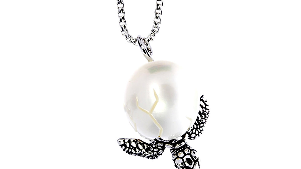 Turtle Egg pendant, a baby turtle emerges from a carved freshwater pearl