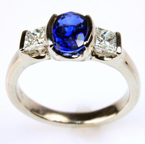 oval sapphire center w/ princess cut accents