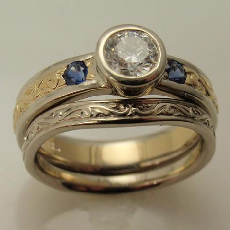bezel set diamond two toned engraved wedding set w/ sapphire accents