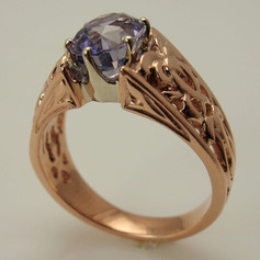 rose gold celtic cathedral band w/ white gold six prong head around oval sapphire
