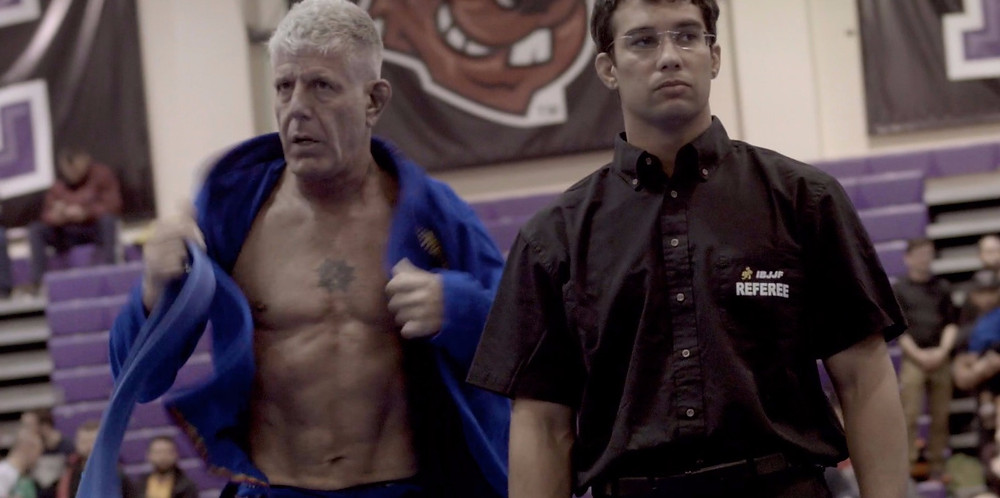 Anthony Bourdain with a 6pack