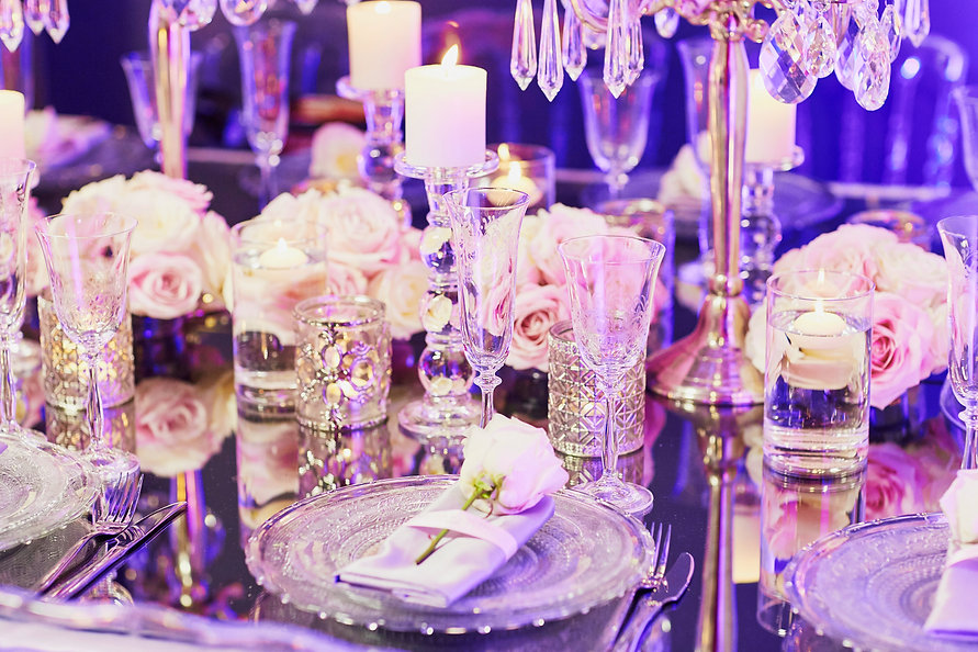 Beautiful table set with candles and flo