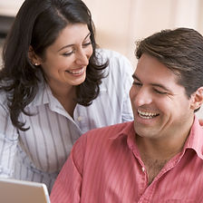 Couple in kitchen with paperwork using l