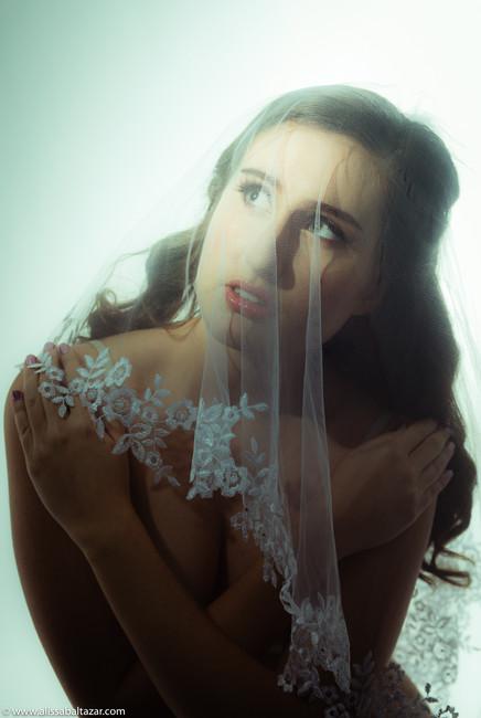 Bride bouduir nude photo session with veil.  Hamilton alternative wedding photographer.