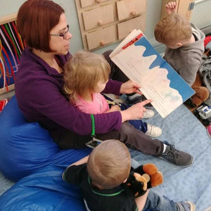 Educator Reading Story to Children