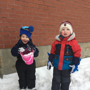 two children playing in the snow