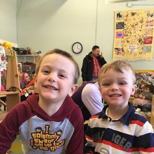 two boys smiling in nursery school