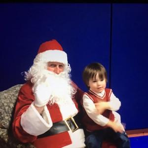 boy sitting on Santa's knee.jpg