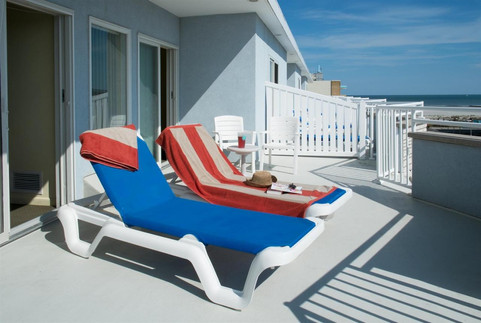 Private deck of a townhouse unit with lounge chairs.