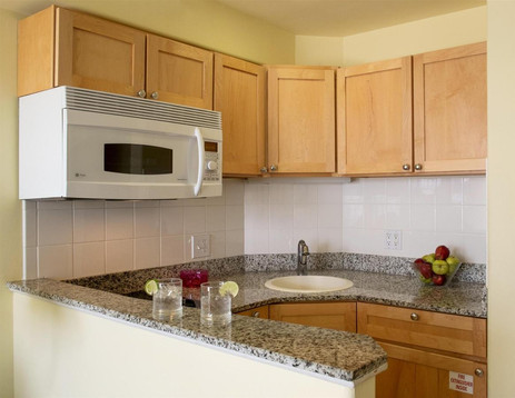 Kitchen view with granite countertops.