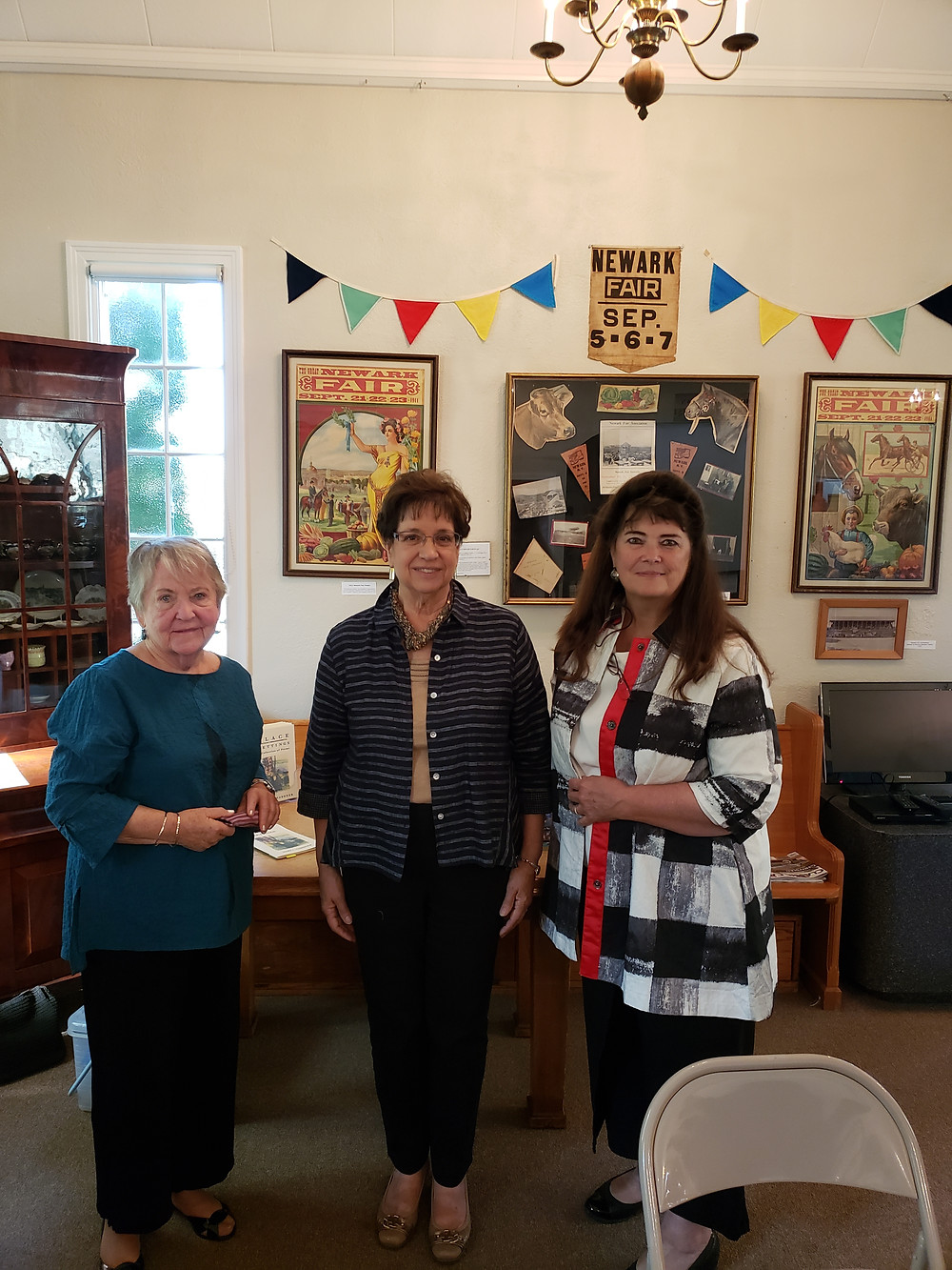 CNY Branch past-presidents Mary Garnder (left), Janet Fagal (center) and current president Nancy Dafoe (right) read poetry in tribute to the late Pearl Newton Rook, a former CNY Branch President.