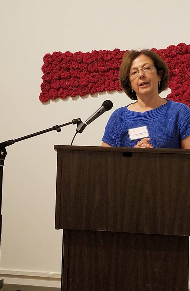 Lorraine Arsenault reciting her poetry inspired by the art exhibited at the Schweinfurth Art Center.