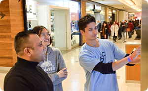 Lee showing students how to navigate in a mall