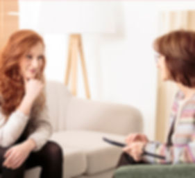 Smiling woman talking to a wellness coac