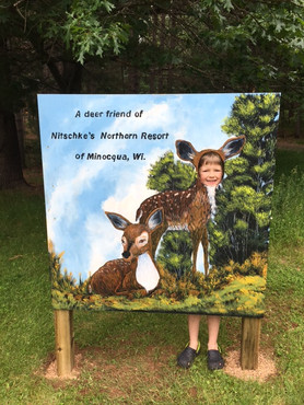 girl gets picture taken in front of sign that says best resort in wisconsin