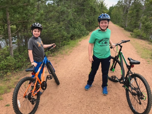 kids on bikes on trail