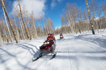 snowmobiling on trail