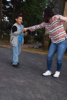 boys dancing with woman at resort