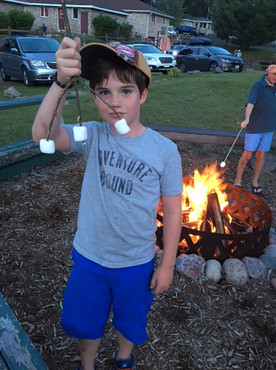 roasting marshmellows around campfire