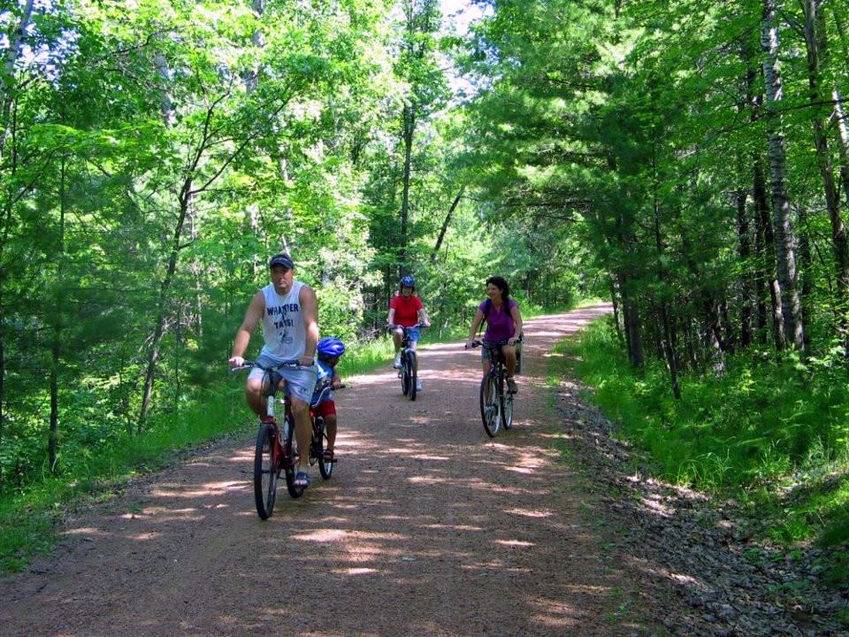 family biking on bearskin trail wisconsin