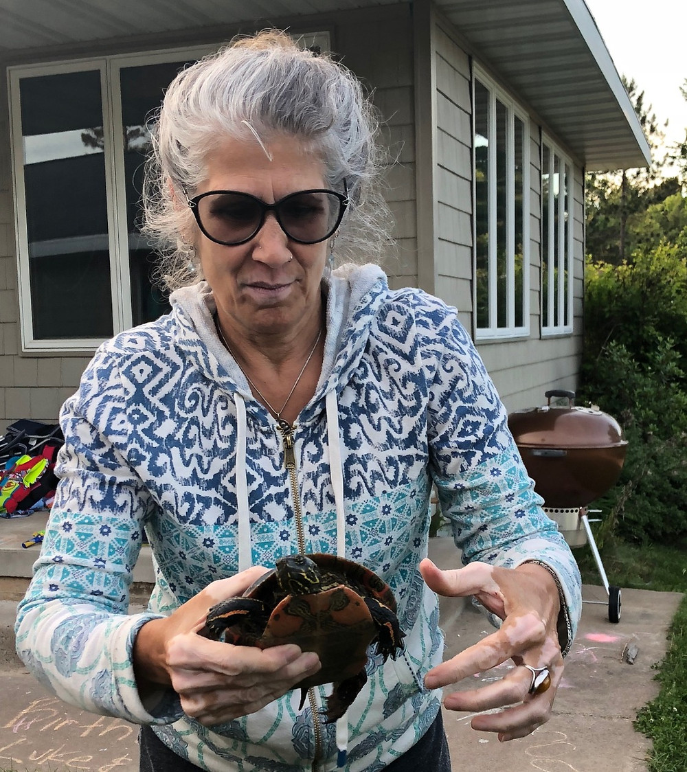 woman still holding turtle