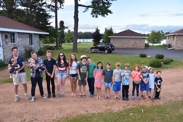 family of children outside resort