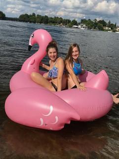 having fun at northern resort on blow up flamingo raft