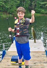 boy catches big fish on pier
