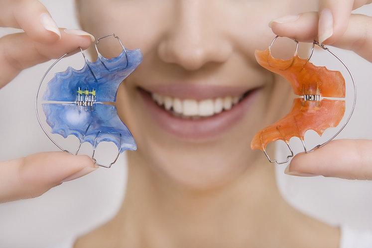 Beautiful Smiling Girl Holding blue Reta