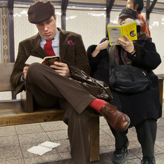 he is reading _Gone With The Wind_, by M