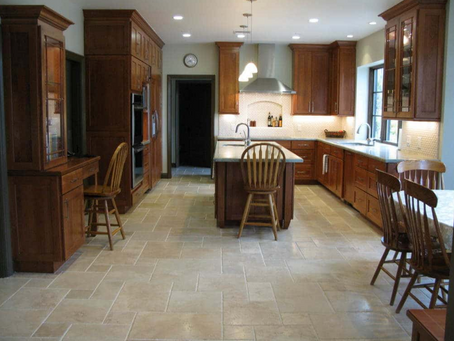 What causes a whitish residue on grout?