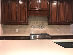 marble backsplash w/ mural