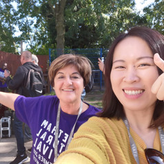 Marysia & Welcome Centre volunteer enjoying the weather and the music @ Welcome Centre (CCF 2019)