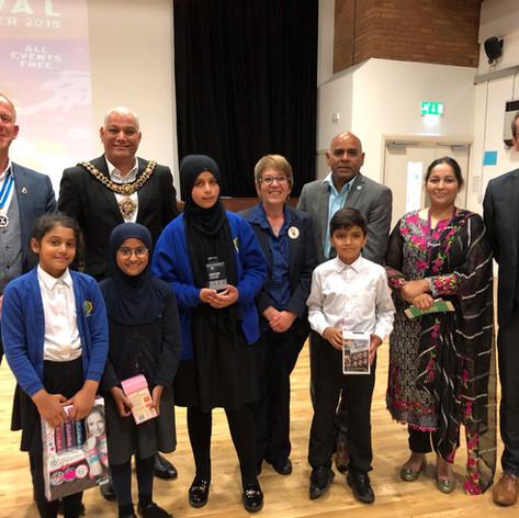 Artists awared their prizes by Poppy (Tesco), Gareth (MJM), Cllr. Hassan & High Sheriff Mark Adlestone @ Abraham Moss Community School (CCF 2019)