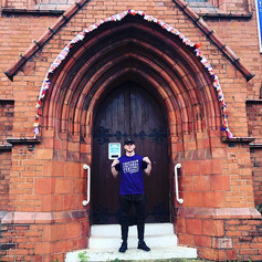 Aaron poses outside with his CCF t-shirt @ Trinity United Church (CCF 2019)