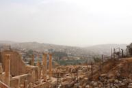 ruins against the modern city