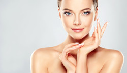 Beautiful Young Woman with Clean Fresh Skin  touch own face .jpg Facial  treatment   .jpg Cosmetolog