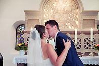 Kuss Brautpaar Hochzeitsfotograf Hochzeitsfoto Hochzeitsreportage Kirche
