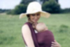Famielenportrait Familienfoto Familienfotograf Tragetuch Mutter