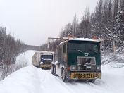 Cranbrook BC mobile home moving company winter transport two trucks