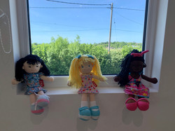 Doll on the Window Sill