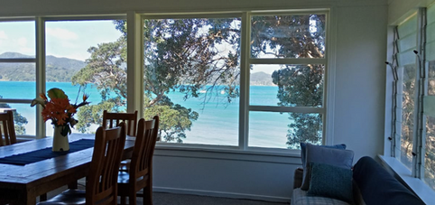 Kitchen dining space panormic harbour views