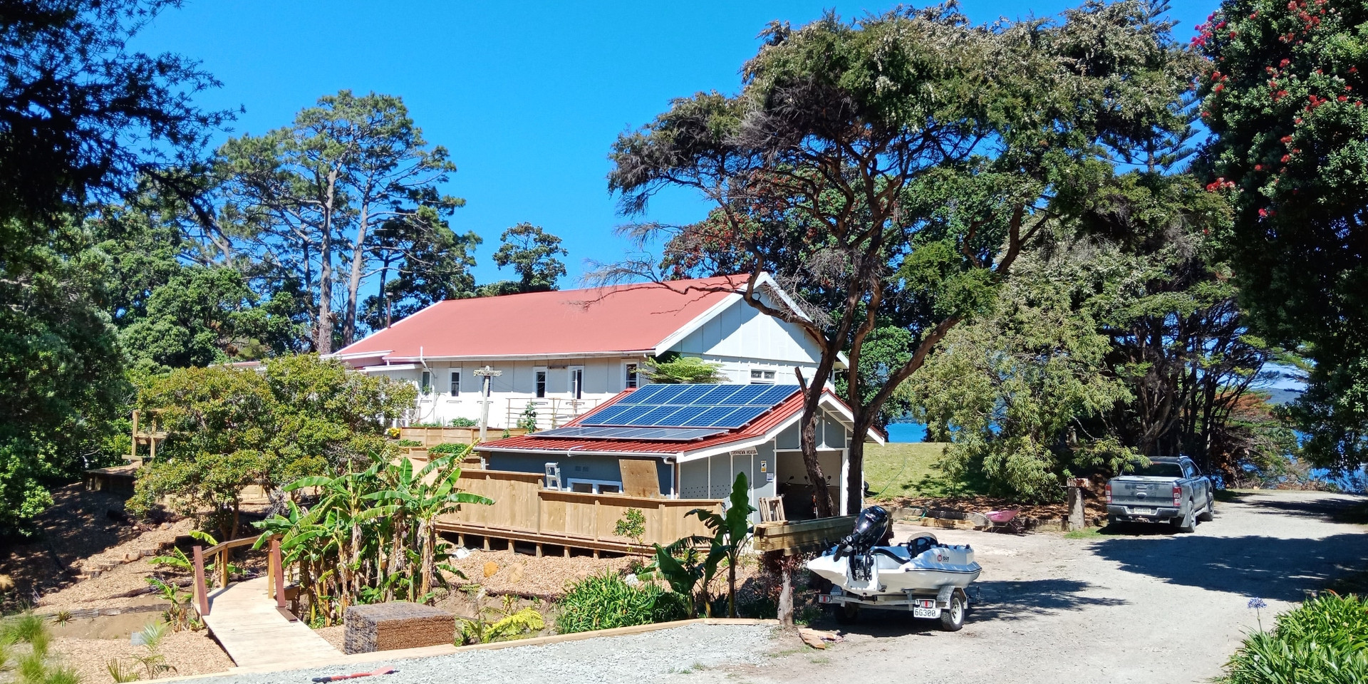 Car park view of Tryphena House. All our electricity is generated by the solar panels on the garage roof