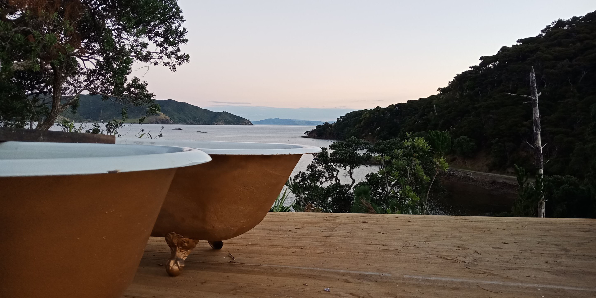 Outdoor heated bath tubs with views back to the Coromandel