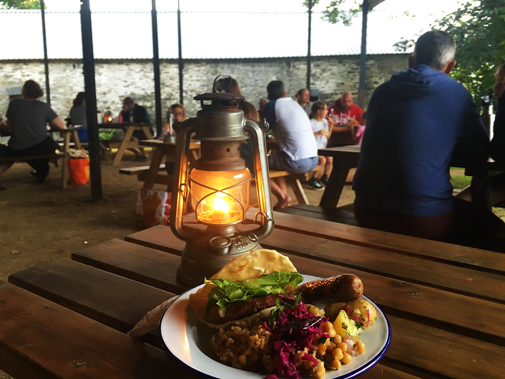 Top of the Woods Camping Glamping Eco Holiday Pembrokeshire Wales UK - Food in the Dutch Barn - Communal Evening Meal